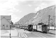 """Early morning - San Juan and freight both waiting for power.<br /> D&RGW  Durango, CO  Taken by Barriger, John W. III - 1946<br /> In book """"Durango: Always a Railroad Town (1st ed.)"""" page 34"""