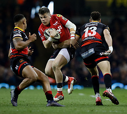 Scarlets' Steff Evans evades the tackle of Dragons' Ashton Hewitt<br /> <br /> Photographer Simon King/Replay Images<br /> <br /> Guinness PRO14 Round 21 - Dragons v Scarlets - Saturday 28th April 2018 - Principality Stadium - Cardiff<br /> <br /> World Copyright © Replay Images . All rights reserved. info@replayimages.co.uk - http://replayimages.co.uk