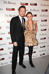 STELLA McCARTNEY and ALISTAIR WILLIS at The Love Ball hosted by Natalia Vodianova and Lucy Yeomans to raise funds for The Naked Heart Foundation held at The Round House, Chalk Farm, London on 23rd February 2010.