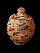 Yupik grass basket with flying sandhill cranes woven by Susanna Chanar of Toksook Bay, Alaska.  (10 x 8 inches)  Please note:  Licensing of this photo requires a license and additional fee to be paid to the basket's creator, Susanna Chanar)
