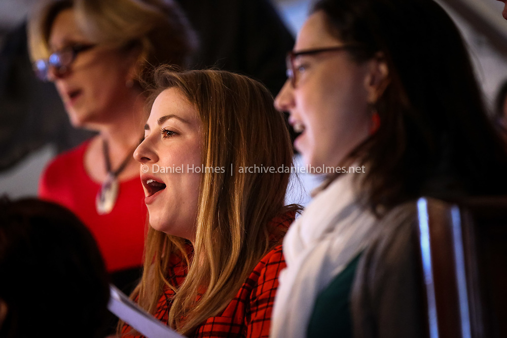 (12/5/15, FRAMINGHAM, MA) Jackie Chalem, of Boston, sings with the Voices of Metrowest during the Caroling on the Common event at the Historic Village Hall in Framingham on Saturday. Daily News and Wicked Local Photo/Dan Holmes