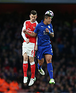 Arsenal's Laurent Koscielny tussles with Leicester's Leonardo Ulloa during the Premier League match at the Emirates Stadium, London. Picture date: April 26th, 2017. Pic credit should read: David Klein/Sportimage