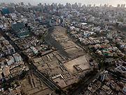 In this Oct. 10, 2017 photo, the pre-Columbian archeological site Pucllana is surrounded by urban sprawl in the Miraflores district of Lima, Peru. An estimated 46,000 pre-colonial sites mark the country's landscape, and about 400 of those are located in Lima, which has the largest number of pre-colonial archaeological zones in South America.