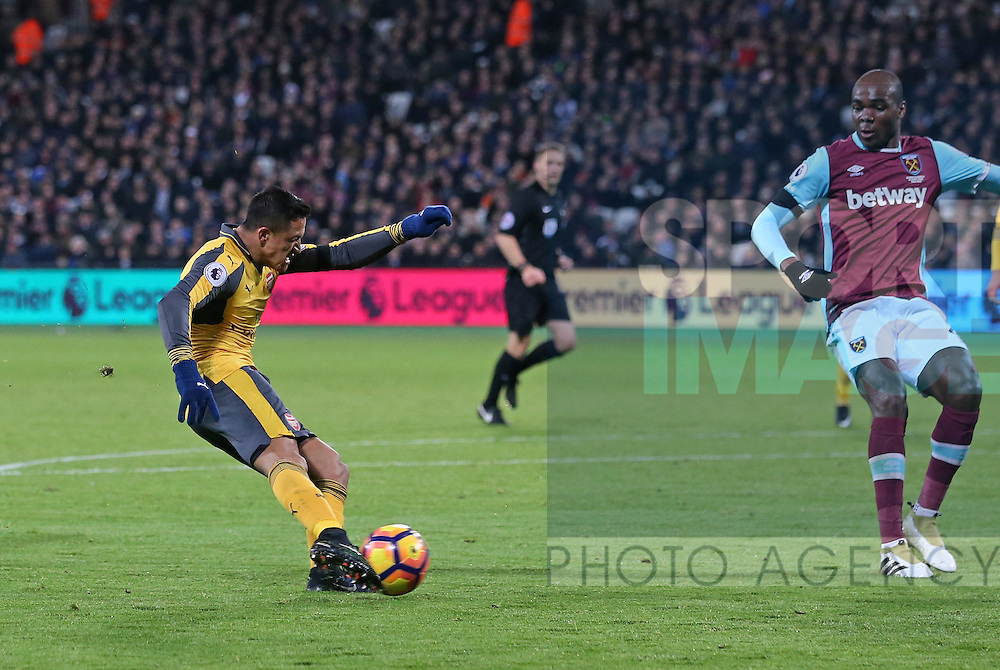 Arsenal's Alexis Sanchez scoring his sides second goal during the Premier League match at the London Stadium, London. Picture date December 3rd, 2016 Pic David Klein/Sportimage