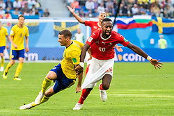 July 3, 2018 - St Petersburg, Russia - 180703 Marcus Berg of Sweden pulls on the shorts of Johan Djourou of Switzerland during the FIFA World Cup round of 16 match between Sweden and Switzerland on July 3, 2018 in ST Petersburg..Photo: Petter Arvidson / BILDBYRÃ…N / kod PA / 87748 (Credit Image: © Petter Arvidson/Bildbyran via ZUMA Press)