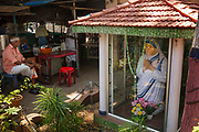 Mother Teresa shrine in front of a street market on 28th February 2018 in Kochi, Kerala, India. She spent many years in Calcutta, India where she founded the Missionaries of Charity, a religious congregation devoted to helping those in great need.
