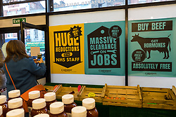 © Licensed to London News Pictures. 23/11/2018. London, UK.  Empty fresh vegetable trays and signs inside the People's Vote campaign stunt pop-up shop in Peckham High Street on Black Friday to show that the government's Brexit deal is a bad deal and the shop is stocked with household products, such as 'chlorinated' chicken to illustrate the bad deal. Photo credit: Vickie Flores/LNP