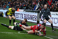 DTH Van Der Merwe of Scarlets ®dives in the corner to score his 1st half try as Dan Baker of the Ospreys attempts to stop him.Guinness Pro12 rugby match, Ospreys v Scarlets at the Liberty Stadium in Swansea, South Wales on Saturday 26th March 2016.<br /> pic by  Andrew Orchard, Andrew Orchard sports photography.