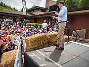 17 AUGUST 2019 - DES MOINES, IOWA: Iowa State Fair goers listen to Representative SETH MOULTON (standing on stage) at the Des Moines Register Political Soapbox. Moulton, a US Marine veteran who served in Iraq, is running to be the Democratic candidate for the US Presidency in 2020. Iowa traditionally hosts the the first selection event of the presidential election cycle. The Iowa Caucuses will be on Feb. 3, 2020.          PHOTO BY JACK KURTZ