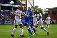Peterborough United defender Jason Naismith (2) watches his header go just wide during  the EFL Sky Bet League 1 match between Peterborough United and Luton Town at London Road, Peterborough, England on 18 August 2018.