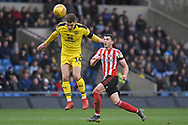 Oxford United midfielder Josh Ruffels (14) heads the ball away during the EFL Sky Bet League 1 match between Oxford United and Sunderland at the Kassam Stadium, Oxford, England on 9 February 2019.