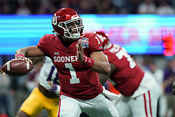 Jalen Hurts #1 of the Oklahoma Sooners drops back to pass during the first half against the LSU Tigers in the 2019 College Football Playoff Semifinal at the Chick-fil-A Peach Bowl on Saturday, Dec. 28, in Atlanta. (Jason Parkhurst via Abell Images for the Chick-fil-A Peach Bowl)