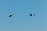 Republic Seabee and J3 Cub flying over the Seaplane base, Airventure 2017.