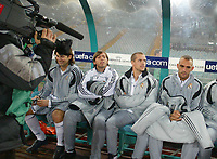 In front of the TV cameras, Michael Owen sits on the Real Madrid bench.