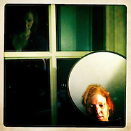 This is a self portrait in a vanity mirror and bathroom window. It is a reflection of how humbling motherhood can be which, for me, is probably a good thing.