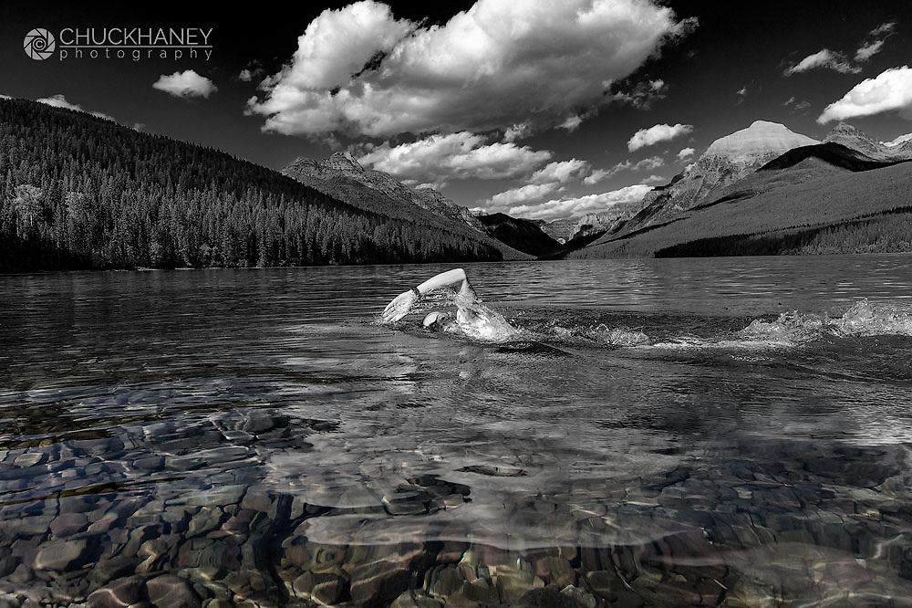 Swimming in Bowman Lake in Glacier National Park, Montana, USA MR