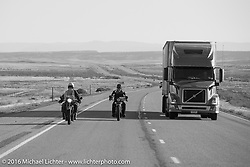 Jim Petty (R) riding his 1927 Indian Chief next to John Landstrom on his 1928 BMW R62 on interstate-70 after leaving Grand Junction on the morning of stage 11 (289 miles) of the Motorcycle Cannonball Cross-Country Endurance Run, which on this day ran from Grand Junction, CO to Springville, UT., USA. Tuesday, September 16, 2014.  Photography ©2014 Michael Lichter.