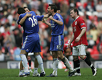 Photo: Lee Earle.<br /> Chelsea v Manchester United. The FA Cup Final. 19/05/2007.United's Wayne Rooney (R) looks dejected as Chelsea's Joe Cole, John Terry and Frank Lampard celebrate.