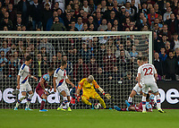 Football - 2019 / 2020 Premier League - West Ham United vs. Crystal Palace <br /> <br /> Sebastien Haller (West Ham United) on the floor slides the ball home to open the scoring through the legs of Vincente Gusita (Crystal Palace) at the London Stadium<br /> <br /> COLORSPORT/DANIEL BEARHAM