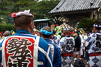 Wearing a Harumaki at Kamakura Matsuri - Japanese festivals are traditional festive occasions with their roots in Chinese festivals having undergone dramatic changes as they mixed with local customs.  Such events are usually sponsored by the local shrine though they can occasionally be secular.