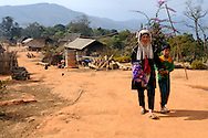 Burma/Myanmar. Woman on the road in the Akha village.