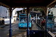 A passenger boards an Arriva bus at the bus stop outside Conwy town centre station, on 4th October 2021, in Conwy, Gwynedd, Wales.