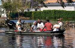 05 Sept  2005. New Orleans, Louisiana. Post hurricane Katrina.<br /> A boat load of some of the last evacuees are rescued from Uptown New Orleans.<br /> Photo; ©Charlie Varley/varleypix.com