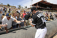 GLENDALE, AZ - MARCH 05:  Paul Konerko #14 of the Chicago White Sox signs autographs prior to the game against the Los Angeles Dodgers on March 5, 2012 at The Ballpark at Camelback Ranch in Glendale, Arizona. The Dodgers defeated the White Sox 6-4.  (Photo by Ron Vesely)  Subject:  Paul Konerko