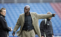 Photo: Paul Thomas.<br /> Huddersfield Town v Swindon Town. Coca Cola League 1. 29/10/2005. <br /> <br /> Swindon manager Iffy Onuora is not happy and lets the fourth offical know about it.