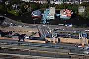 Nederland, Groningen, Groningen Stad, 08-09-2009; Groninger Museum in het water van de Zwaaikom van het Verbindingskanaal, het station op het Stationsplein (Hoofdstation) in de voorgrond.Groninger Museum in the water of the turning basin of the Verbindingskanaal (canal), the railway station (Main Station) in the foreground.Voorbeeld/Example Postmodernisme / Deconstructivisme (architecten/architects Coop Himmelb(l)au, Alessandro Mendini, Philippe Starck.luchtfoto (toeslag); aerial photo (additional fee required); .foto Siebe Swart / photo Siebe Swart