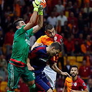 Galatasaray's Burak Yilmaz (C) and Mersin idman Yurdu's goalkeeper Muammer Yildirim (L) during their Turkish Super League soccer match Galatasaray between Mersin idman Yurdu at the AliSamiYen Spor Kompleksi TT Arena at Seyrantepe in Istanbul Turkey on Saturday, 12 September 2015. Photo by Kurtulus YILMAZ/TURKPIX