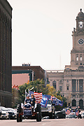 26 SEPTEMBER 2020 - DES MOINES, IOWA: GARY LEFFLER leads a motorcade supporting the reelection of President Donald J. Trump across the Court Ave Bridge in downtown Des Moines. More than 1,500 people in 500 vehicles participated in motorcade through Des Moines Saturday. They started in the suburbs south of downtown, drove through downtown, and ended at the State Capitol.       PHOTO BY JACK KURTZ