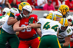 NORMAL, IL - October 05: Jacob Powell takes a right upper cut to the chin under his face protection complements of Cordell Volson during a college football game between the ISU (Illinois State University) Redbirds and the North Dakota State Bison on October 05 2019 at Hancock Stadium in Normal, IL. (Photo by Alan Look)