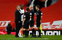 Football - 2020 / 2021 Premier League - Manchester United  vs Tottenham Hotspur - Old Trafford<br /> <br /> Ole Gunnar Solskjaer manager of Manchester United speak to referee Anthony Taylor at Old Trafford<br /> <br /> COLORSPORT/LYNNE CAMERON