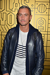 RICHARD NICOLL at a party to celebrate 10 years of footware designer Nicholas Kirkwood held at 9 Adam Street, London on 19th September 2015.