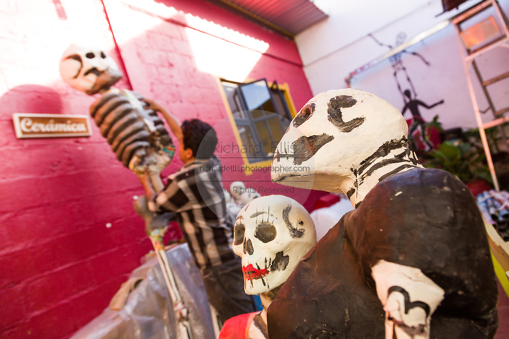 An artist puts the finishing touches on a skeleton decoration in preparation for the Day of the Dead Festival known in spanish as Día de Muertos on October 26, 2014 in Oaxaca, Mexico.