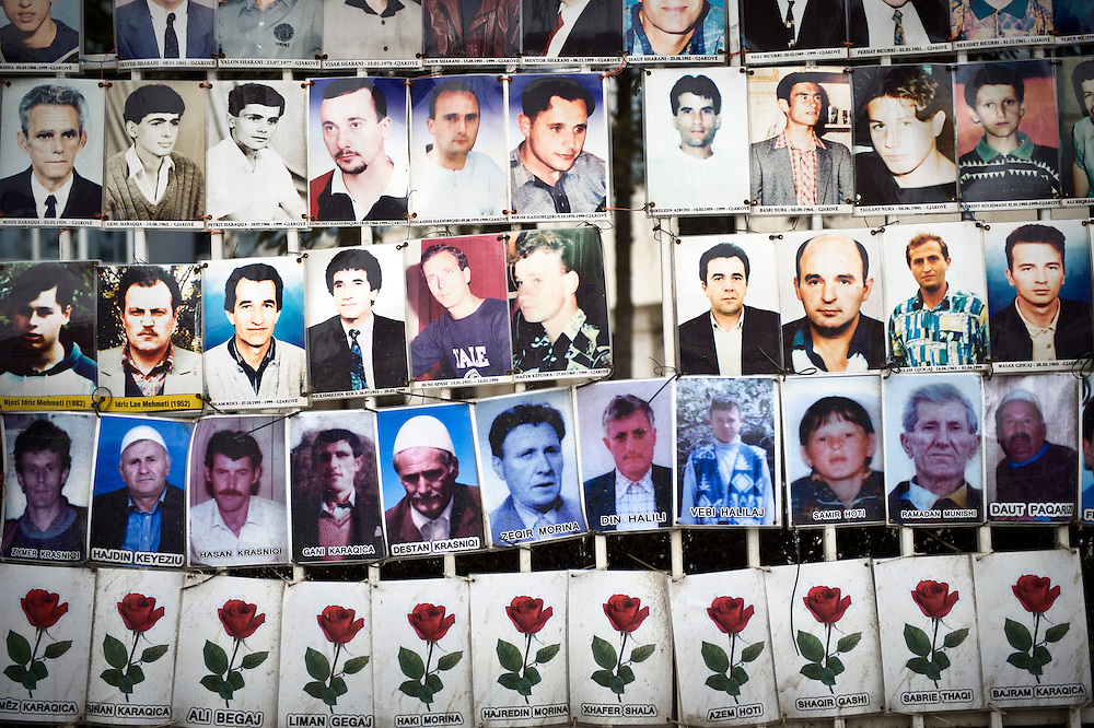 """Pristina, Kosovo 17 February 2011<br /> A white metal fence is lined with portraits of missing people who had not been seen since 1998/99, the years of the Kosovo War, in centre Pristina.<br /> After the Kosovo War and the 1999 NATO bombing of Yugoslavia, the territory of Kosovo came under the interim administration of the United Nations Mission in Kosovo (UNMIK), and most of those roles were assumed by the European Union Rule of Law Mission in Kosovo (EULEX) in December 2008. <br /> In February 2008 individual members of the Assembly of Kosovo declared Kosovo's independence as the Republic of Kosovo. Its independence is recognised by 75 UN member states. <br /> On 8 October 2008, upon request of Serbia, the UN General Assembly adopted a resolution asking the International Court of Justice for an advisory opinion on the issue of Kosovo's declaration of independence.<br /> On 22 July 2010, the ICJ ruled that Kosovo's declaration of independence did not violate international law, which its president said contains no """"prohibitions on declarations of independence"""".<br /> Photo: Ezequiel Scagnetti"""
