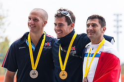 Queen Elizabeth Olympic Park, London. September 13th 2014. Medalists Jaco Van Gass, Gold (C), Terry Byrne, Silver (L) and FRance's Henri Rebujent, Bronze, (R) from the Men's IRB2 circuit race event pose for pictures as wounded servicemen and women from 13 different countries compete for sporting glory during the cycling competition at the Invictus Games.