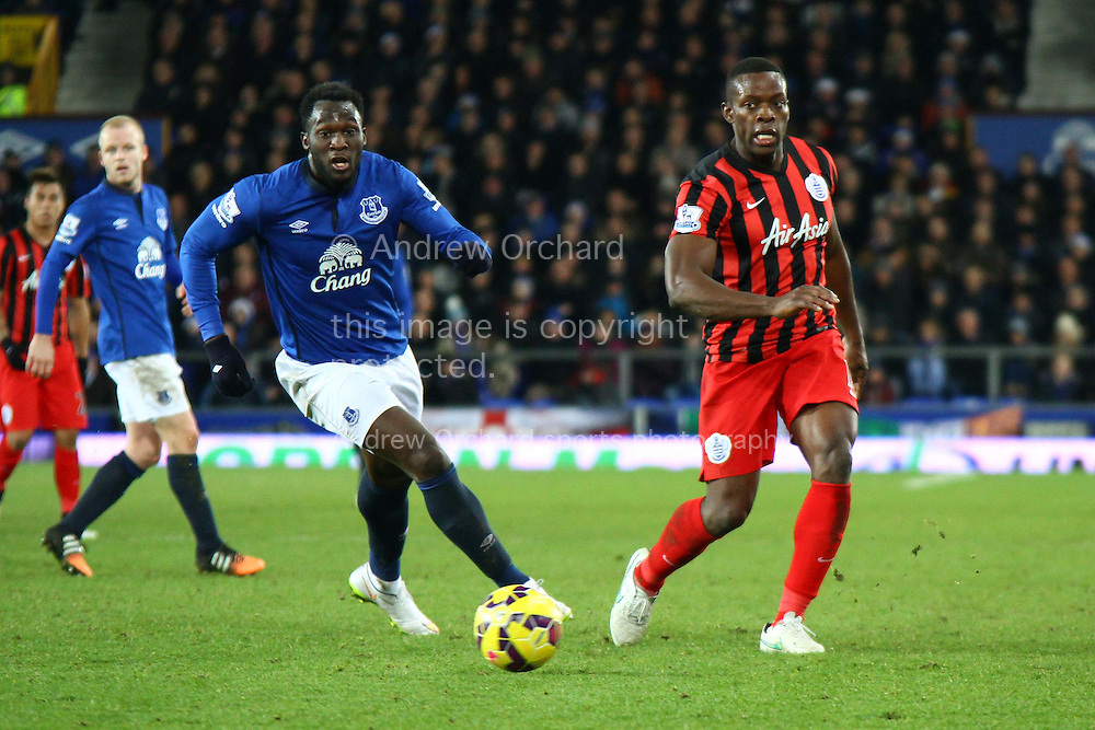 Romelu Lukaku of Everton goes past Nedum Onuoha of Queens Park Rangers. Barclays Premier league match, Everton v Queens Park Rangers at Goodison Park in Liverpool, Merseyside on Monday 15th December 2014.<br /> pic by Chris Stading, Andrew Orchard sports photography.