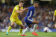 Ruben Loftus-Cheek of Chelsea ®  is intercepted by Tom Lockyer of Bristol Rovers. EFL Cup 2nd round match, Chelsea v Bristol Rovers at Stamford Bridge in London on Tuesday 23rd August 2016.<br /> pic by John Patrick Fletcher, Andrew Orchard sports photography.
