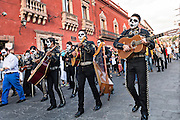 A mariachi band dressed as skeletons for the Day of the Dead festival process through the Jardin Principal October 28, 2016 in San Miguel de Allende, Guanajuato, Mexico. The week-long celebration is a time when Mexicans welcome the dead back to earth for a visit and celebrate life.