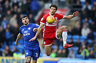 George Friend of Middlesbrough ® gets to the ball ahead of Callum Paterson of Cardiff city.. EFL Skybet championship match, Cardiff city v Middlesbrough at the Cardiff city Stadium in Cardiff, South Wales on Saturday 17th February 2018.<br /> pic by Andrew Orchard, Andrew Orchard sports photography.