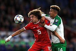 Wales' Ethan Ampadu and Republic of Ireland's Callum Robinson battle for the ball during the League B, Group four match at Cardiff City Stadium. PRESS ASSOCIATION Photo. Picture date: Thursday September 6, 2018. See PA story SOCCER Wales. Photo credit should read: Mike Egerton/PA Wire. RESTRICTIONS: Editorial use only, No commercial use without prior permission.
