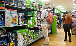 © Licensed to London News Pictures. 14/10/2021. London, UK. Shoppers look at toys in Asda, north London, amid fears of Christmas toys shortages. Retail leaders warn that families should start to shop for Christmas now, amid fears that there may be shortage of presents, food, toys, electrical goods and other products, due to a shortage of HGV lorry drivers. Photo credit: Dinendra Haria/LNP