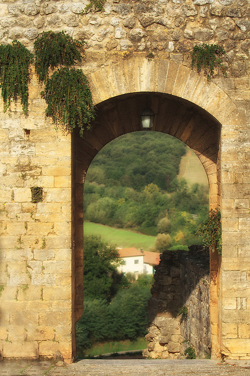 """Archway overlooking the Tuscan countryside in Italy.<br /> <br /> Available sizes:<br /> 12"""" x 18"""" print <br /> 12"""" x 18"""" gallery wrap<br /> See Pricing page for more information."""