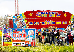 Licensed to London News Pictures. 01/05/2021. London, UK. Families queue up at a Fun Fair in Putney South West London today as members of the public and the Service industry make the most of the Bank Holiday weekend. This month Covid-19 restrictions were lifted with more freedoms to meet friends and have picnics in the parks as pubs and staycations open up for the long May Bank Holiday weekend with temperatures expected to reach 14c in the South East with a possibility of rain forecast. Photo credit: Alex Lentati/LNP