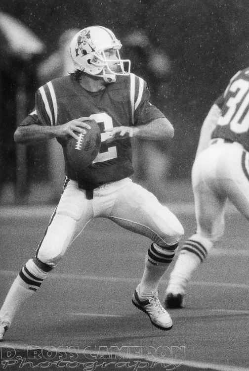 New England Patriots quarterback Doug Flutie (2) drops back to pass during an NFL football game against the New York Jets, Sunday, Nov. 13, 1988 at Giants Stadium in East Rutherford, N.J. Despite completing just 6 of 20 attempts for 78 yards, including one touchdown and two interceptions, Flutie led his team to a 14-13 win over the Jets. (D. Ross Cameron/The Express)