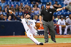 July 21, 2017 - St. Petersburg, Florida, U.S. - WILL VRAGOVIC   |   Times.Tampa Bay Rays third baseman Evan Longoria (3) makes the diving stop on the single by Texas Rangers shortstop Elvis Andrus (1) but can't get him at first base, the go-ahead run scores, in the tenth inning of the game between the Texas Rangers and the Tampa Bay Rays at Tropicana Field in St. Petersburg, Fla. on Friday, July 21, 2017. (Credit Image: © Will Vragovic/Tampa Bay Times via ZUMA Wire)