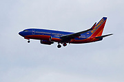 Southwest Airlines jet flying near LaGuardia Airport in New York City.