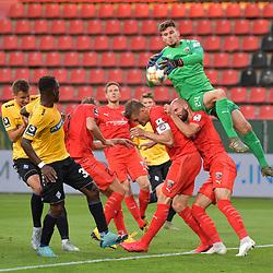 Spiel am 35 Spieltag in der Saison 2019-2020 in der 3. Bundesliga zwischen dem FC Ingolstadt 04 und dem SV Waldhof Mannheim am 24.06.2020 in Ingolstadt. <br /> <br /> Torwart Fabijan Buntic (Nr.24, FC Ingolstadt 04) fliegt auf seinen Teamkollegen, Kevin Koffi (Nr.30, SV Waldhof Mannheim) kommt nicht an den Ball<br /> <br /> Foto © PIX-Sportfotos *** Foto ist honorarpflichtig! *** Auf Anfrage in hoeherer Qualitaet/Aufloesung. Belegexemplar erbeten. Veroeffentlichung ausschliesslich fuer journalistisch-publizistische Zwecke. For editorial use only. DFL regulations prohibit any use of photographs as image sequences and/or quasi-video.